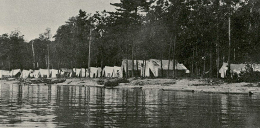 White tents on the bank of Cass Lake, 1914