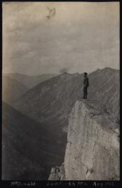 Scanned image of a lantern sldie depicting a man standing on a mountain peak.