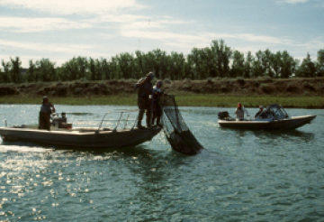 Two fishing boat's net for fish in Iowa Rivers