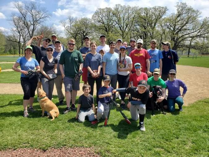Players at the NREM softball game posing on the field