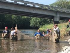 Students wading in river