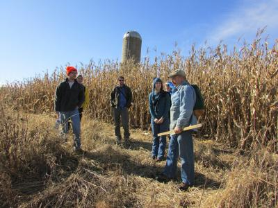 Image of David Gossman discussing prairie reconstruction on his farm