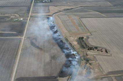 Aerial view of Tim Smith burning his prairie strips in April 2017